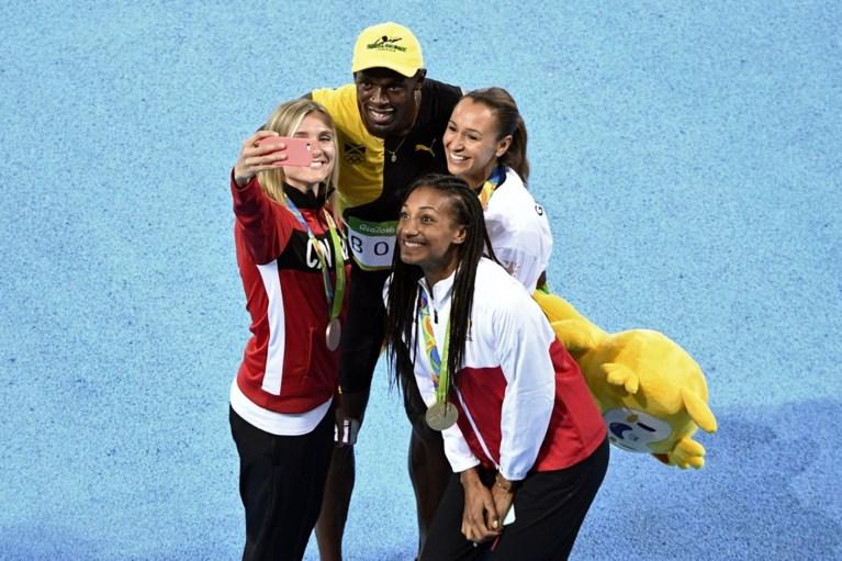 Gouden Thiam scoort een selfie met Bolt na medailleceremonie