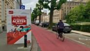 Borden in fietsstraten waarschuwen automobilisten voor inhaalverbod