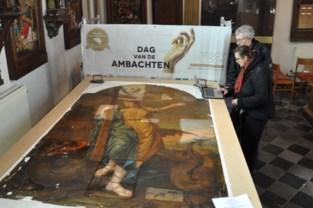 Schilderij van Sint-Margriet ligt op de restauratietafel