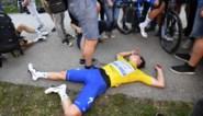 IN BEELD. Zo uitgeput was Remco Evenepoel nadat hij leiderstrui succesvol verdedigde op steile slotklim