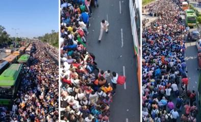 Duizenden ontslagen arbeiders wachten opeengepakt op bus naar huis door lockdown in India