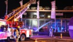Hybridewagen vat vuur in garage: aanzienlijke schade in showroom