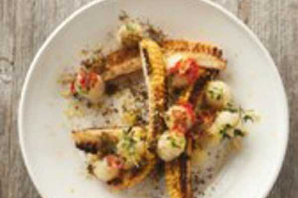 Recept voor barbecue: maistentakels met zwarte quinoa en chili-knolseldercrème