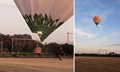 Landende luchtballon kan maar net ontsnappen aan aanstormende trein