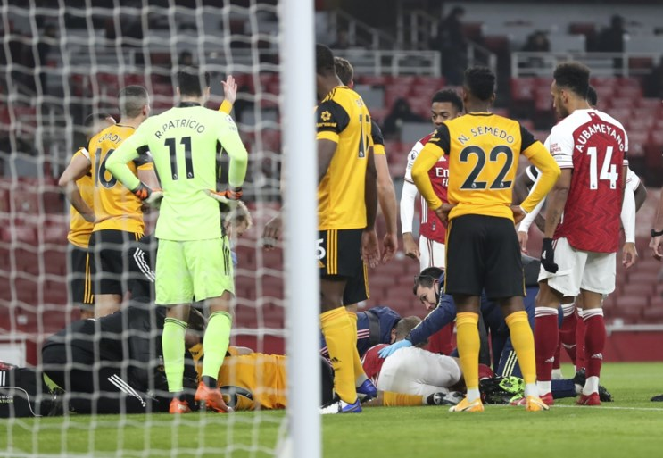 Wolverhampton striker Jimenez remains motionless for minutes after a hard collision