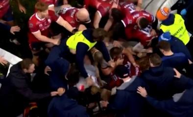 Rugbyster ramt jonge waterdrager omver en zet zo stevige vechtpartij in gang