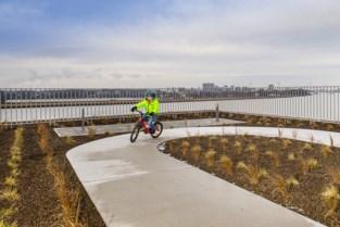 Loop- en fietspiste op dak van woonblok Havn Nieuw Zuid