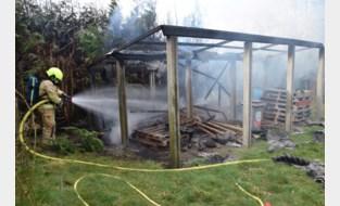 Brand in houtopslagplaats