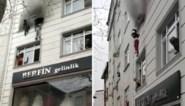 Moeder gooit kinderen in armen van omstanders om ze uit brandend appartement te redden