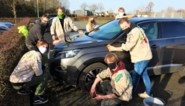 Scouts Drongen spijzen kas met carwash op parking Supra Bazar