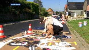 Kunstenaars zetten gezichten van Wout van Aert, Remco Evenepoel, Jolien D'Hoore en Lotte Kopecky op de Smeysberg
