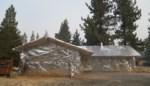 Na bomen ook huizen: Californiërs wikkelen huis in folie uit vrees voor bosbranden